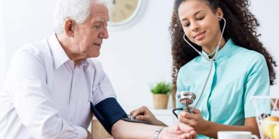 an-older-man-is-having-his-blood-pressure-measured-by-a-woman